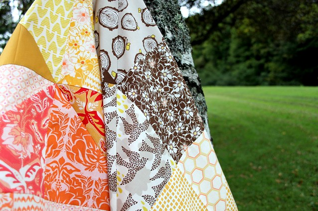 an autumn Sun quilt top -- yellow + orange + brown