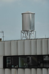 outdoor structure(0.0), silo(0.0), roof(0.0), control tower(0.0), cooling tower(0.0), tower(0.0), storage tank(1.0), architecture(1.0), facade(1.0),