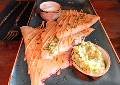 Cheese quesadillas with guacamole and sour cream