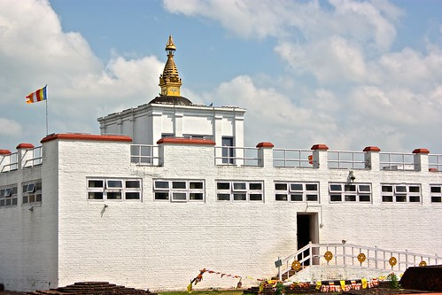 This white brick building protects the archaeological site where Buddha was born