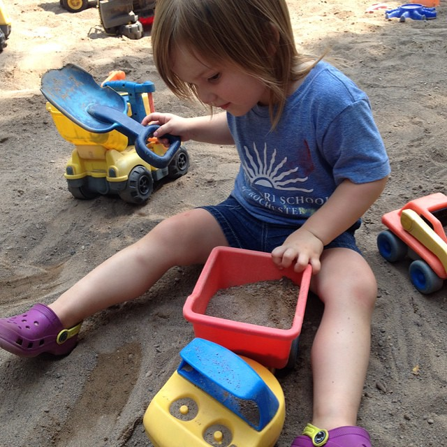 Having fun in the sandbox at playground number 1.