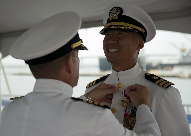 SAN DIEGO -  Cmdr. Hank Kim receives his end of tour, Meritorious Service Medal during Littoral Combat Ship Crew 104's change of command aboard USS Fort Worth (LCS 3).