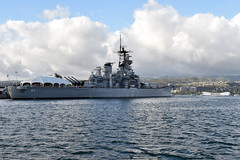 The USS Missouri, on which the armistice ending World War II was signed, and the USS Arizona, which was sunk in the Pearl Harbor attack drawing the United States into the war, as seen during a visit by U.S. Secretary of State John Kerry to Pearl Harbor, Hawaii, on August 13, 2014. It followed a regional military briefing coming at the conclusion of an around the world trip that included stops in Burma, Australia, and the Solomon Islands. [State Department photo/ Public Domain]