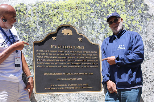 Olympians Norm Tate (left) and John Carlos show off the plaque commemorating the site of the 1968 Olympic Training track at Echo Summit in the Eldorado National Forest. (U.S. Forest Service/Ann Dunsky)