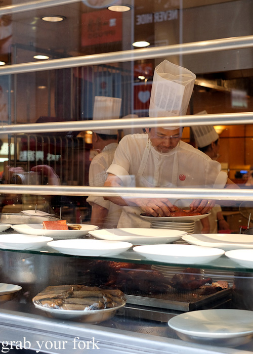 Chef plating up roast good at Yung Kee, Central, Hong Kong