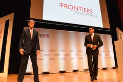U.S. Agency for International Development Administrator Rajiv Shah and the audience thank U.S. Secretary of State John Kerry for delivering the keynote address at the 2014 Frontiers in Development Forum at the Ronald Reagan Building in Washington, D.C., on September 19, 2014. [State Department photo/ Public Domain]