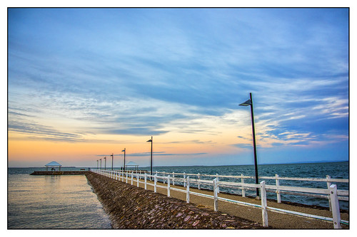 sunset sea sky clouds pier sunsetsandsunrisesgold cloudsstormssunsetssunrises