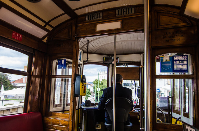 The interior of one of Lisbon's icon tram cars, note the 'Beware of pickpockets' sign.