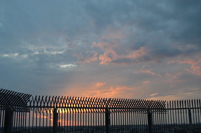 Berlin Park Volkspark Humboldthain iron fence and sunset beyond