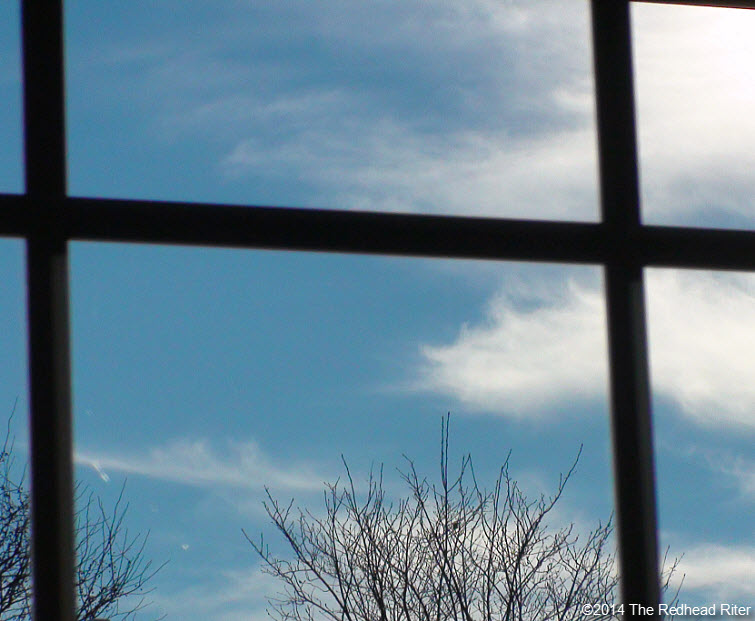look through window blue sky white clouds tree