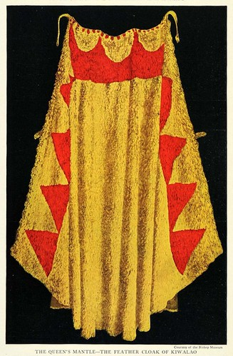 The cousin of Kamehameha the Great, Kiwalaʻō, was slain in battle wearing this cloak. A majority of the cloak consists of yellow feathers from the Mamo; the triangles of red from the I'iwi. © photo: Bishop Museum