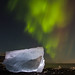 The Northern Light flicker across the ice blocks by Jesper Høgsdal Photography
