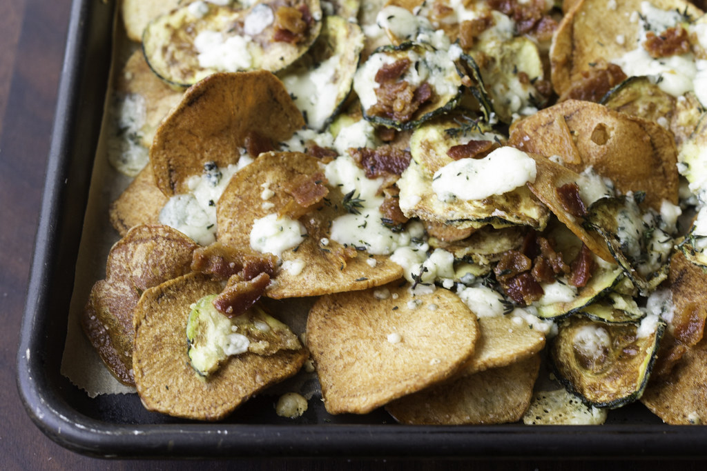 Chips topped with melted gorgonzola, bacon, and thyme