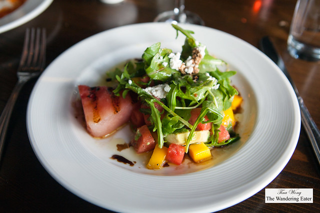 Grilled watermelon salad, avocado, mango, arugula, and goat cheese