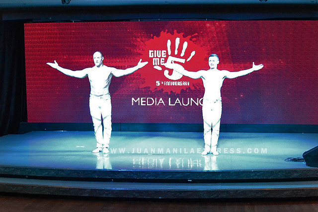 THE POWER DUO. European acrobat performed during the Give Me 5 Media Launch.