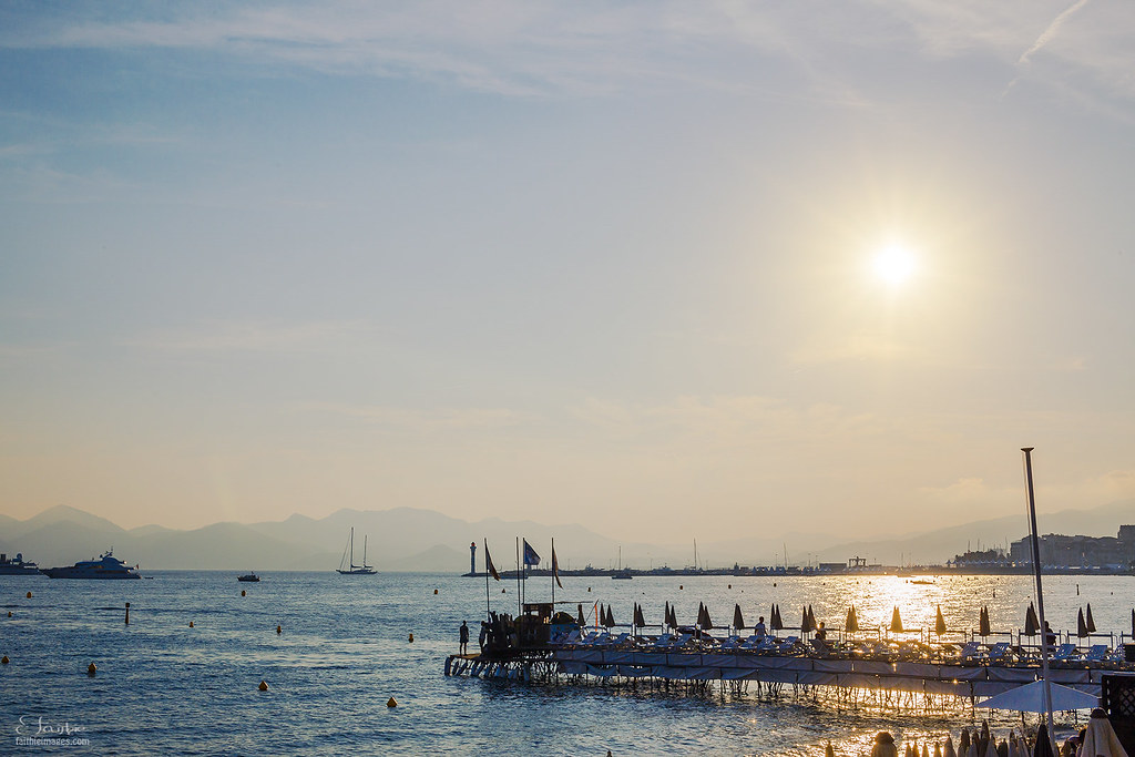 Sun at dusk creating a beautiful pastel light over the beach in Cannes