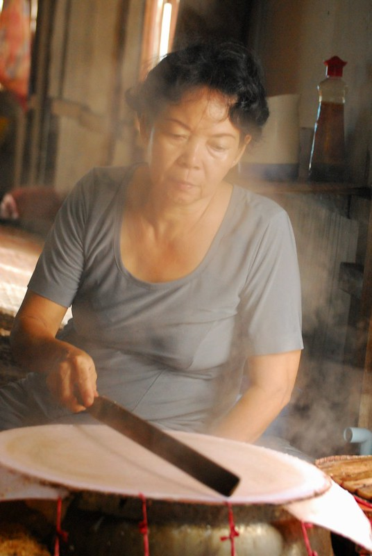 The lady making the rice paper