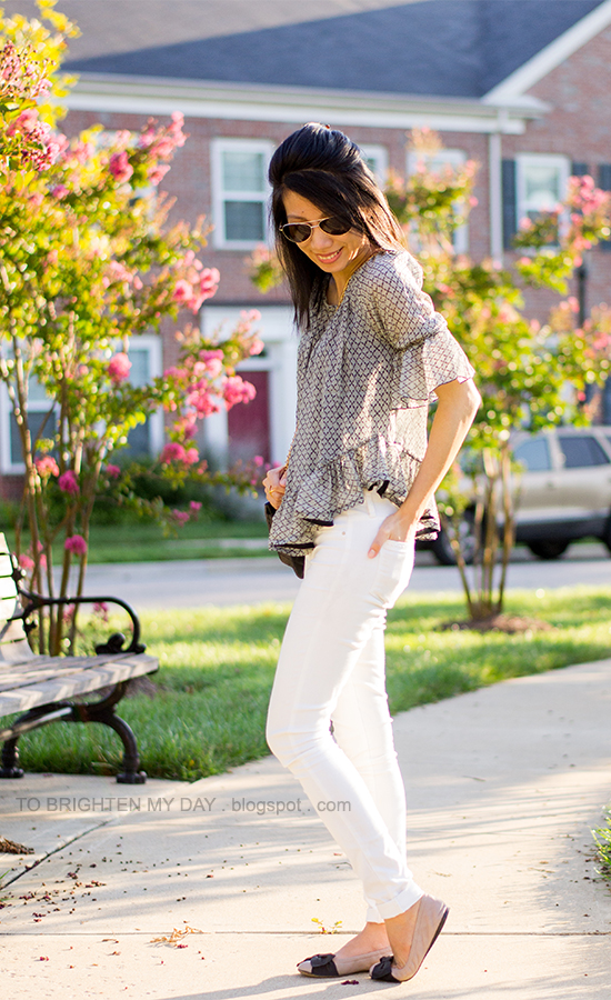 ruffled silk top, black crossbody bag, white jeans, bow ballet flats