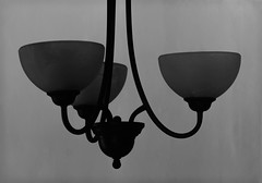 sconce(0.0), ceiling(0.0), street light(0.0), iron(0.0), decor(1.0), lamp(1.0), light fixture(1.0), white(1.0), light(1.0), monochrome photography(1.0), chandelier(1.0), still life photography(1.0), circle(1.0), monochrome(1.0), black-and-white(1.0), lighting(1.0), black(1.0),
