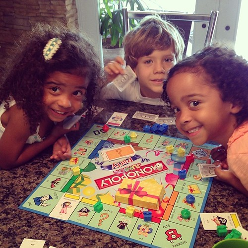 The cousins play a board game -- on a Monday afternoon! It's summertime!