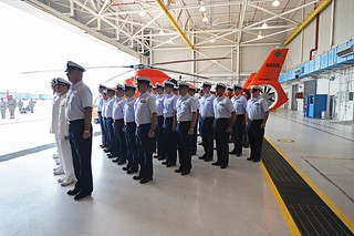 During a change of command ceremony at Coast Guard Air Station Savannah, Georgia, June 26, 2014, Cmdr. Gregory Fuller relinquished command of the air station to Cmdr. John Rivers. The ceremony is a time-honored military tradition that formally recognizes full transfer of responsibility, authority and accountability from one individual to another. (U.S. Coast Guard photo by Petty Officer 1st Class Lauren Jorgensen)