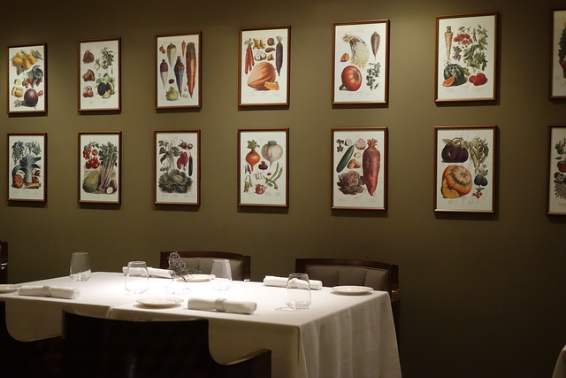 Pictures of vegetables adorning the walls in Gaia's inner dining room.