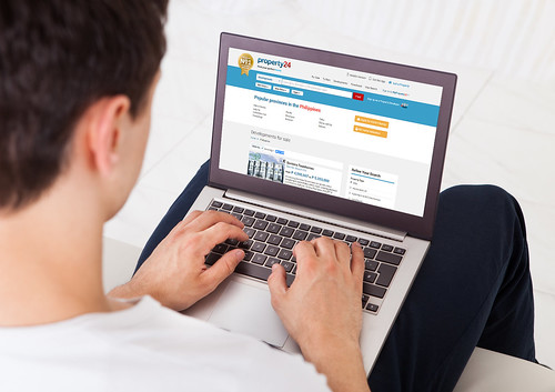 Man Using Social Networking Site On Laptop At Home