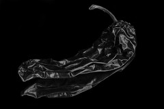 Reflecting On A Chili Pepper In Black And White