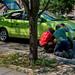 Two Men Repaing a Car on a Street of Harlem, Manhattan, New York, USA