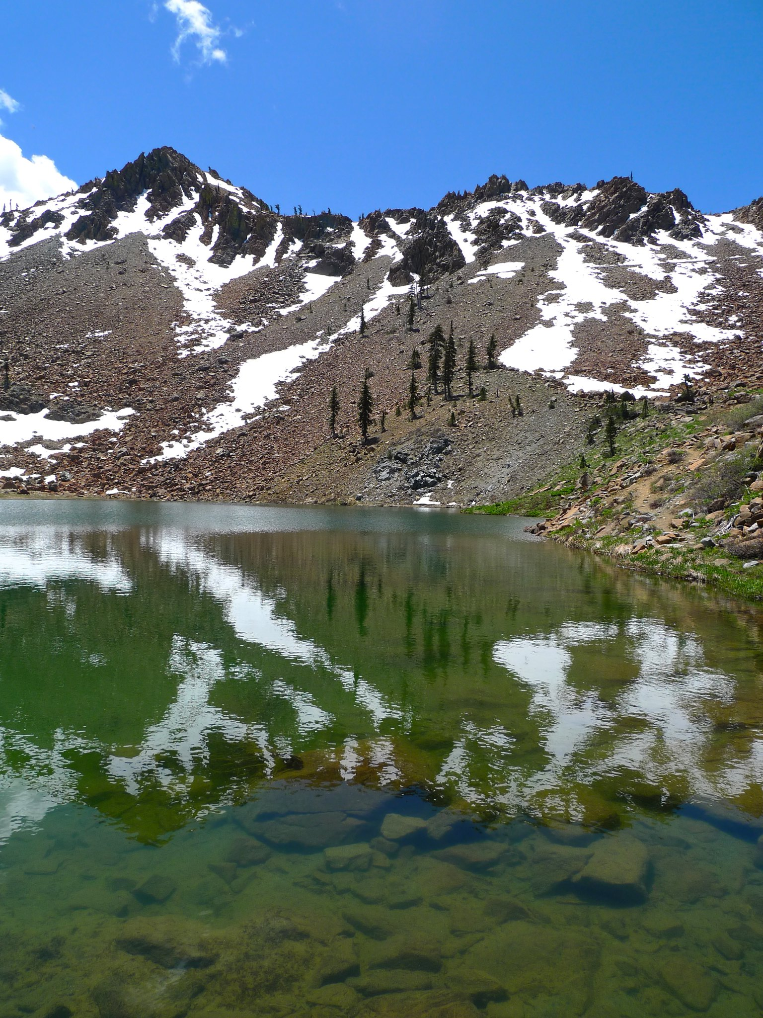 Deer Lake. The trail from Deer Pass to Summit Lake is visible as a slash along the talus and snow on the right.