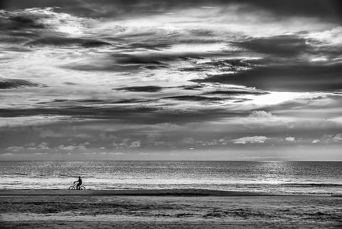 bw storm beach sunrise landscape florida biker daytonabeach