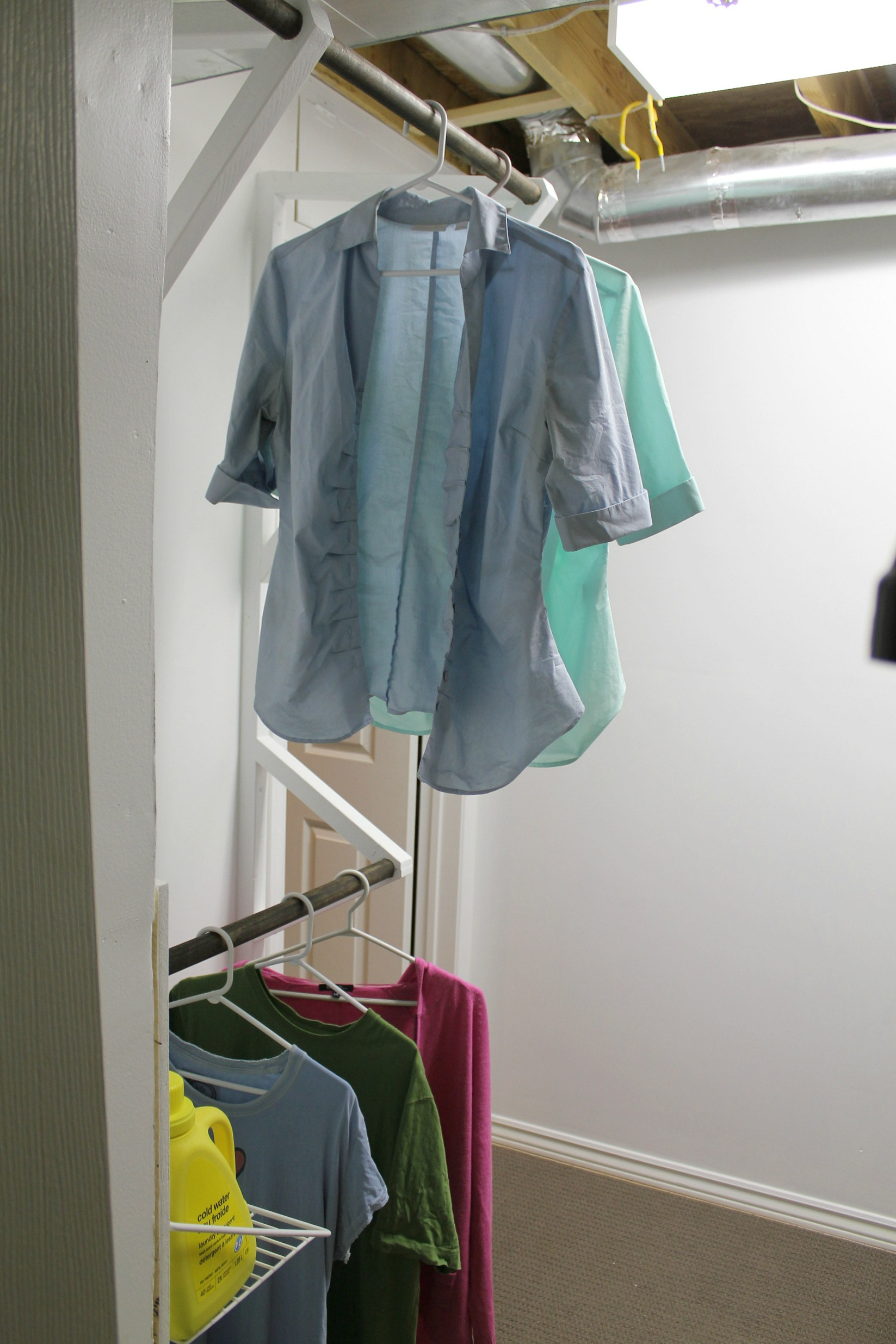 hanging rods laundry room after