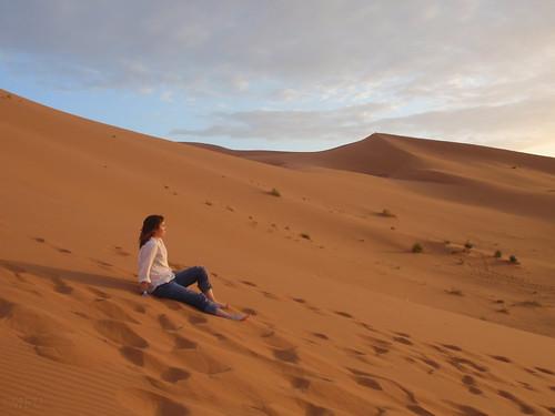 Student on sand dune