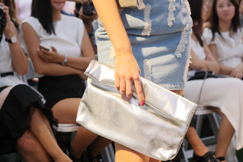 Silver clutch and denim skirt