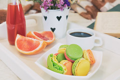 Breakfast in bed with hot coffee and macaroons
