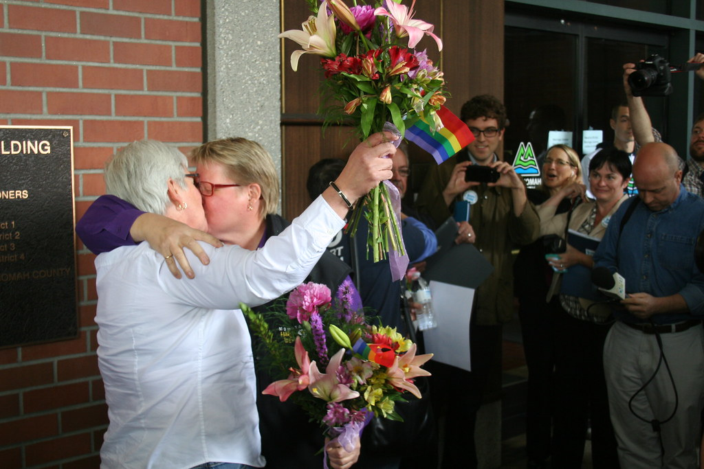 the two plaintiff's in Oregon's marriage case embrace upon hearing their win