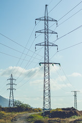 outdoor structure(0.0), mast(0.0), electrical supply(1.0), overhead power line(1.0), line(1.0), transmission tower(1.0), electricity(1.0), tower(1.0), public utility(1.0),