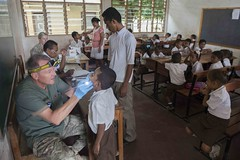 New Zealand Army Maj. Phillip Worthington examines a student at the Tasi Tolu Primary School in Dili, Timor-Leste, during a Pacific Partnership dental engagement June 16. (U.S. Navy/MC2 Derek Stroop)