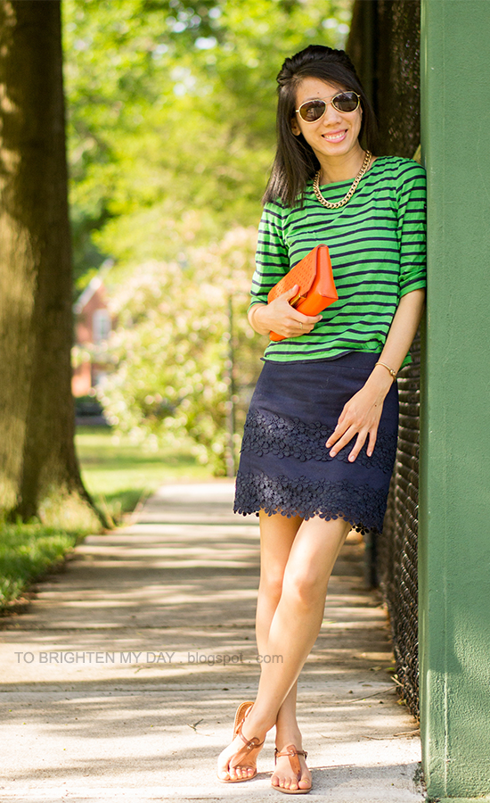 navy/green striped top, navy lace skirt, orange clutch, brown sandals