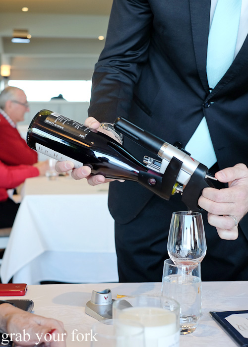 Pouring a single glass of wine using Coravin wine preseravtion system at Jonah's, Whale Beach