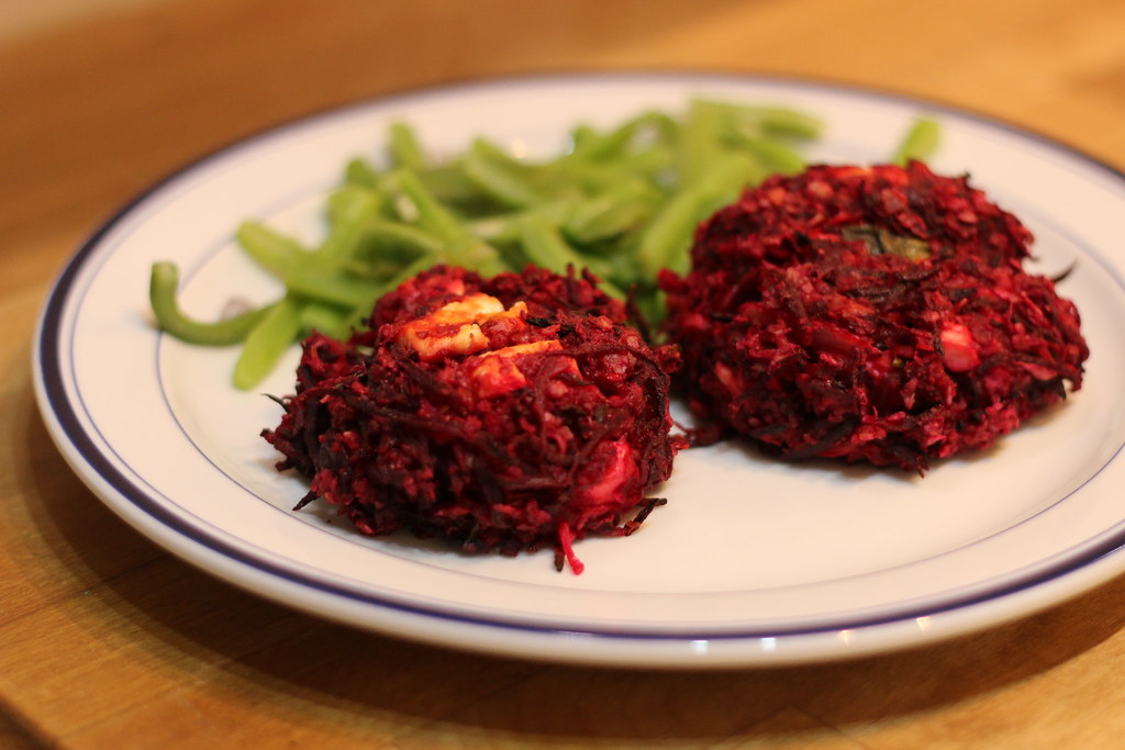 Beetroot and feta burgers on plate