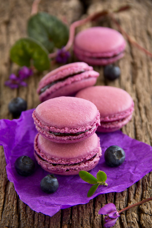 Makarons French pastries stuffed with black currant.
