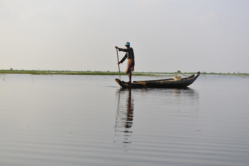 Fisherman returning home, Rohal Suong's conservation pond, Battambang province, Cambodia. Photo by Sylyvann Borei.