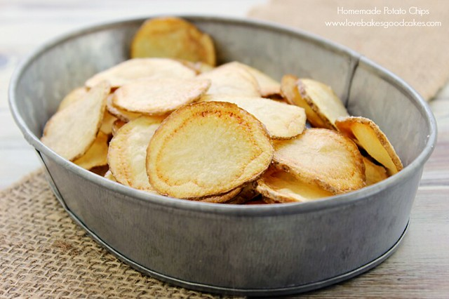 Homemade Potato Chips in a metal bowl close up.