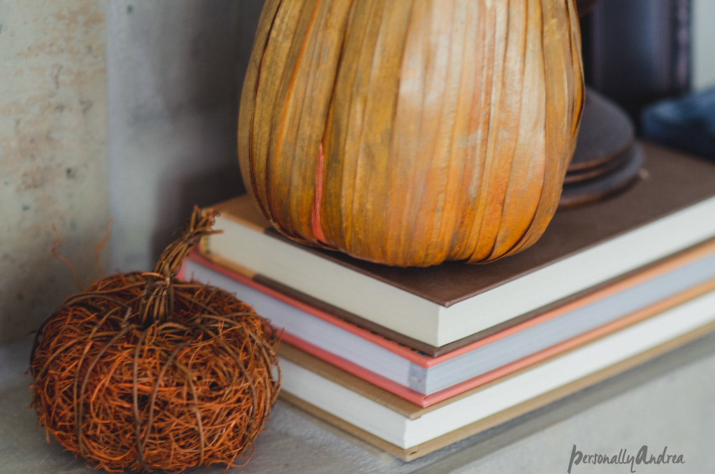 Fall mantel vignette with orange books and faux mini-pumpkins | personallyandrea.com