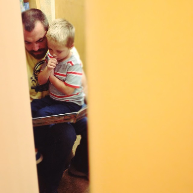 Spying on my boys at the bookstore... ❤️ #love #reading