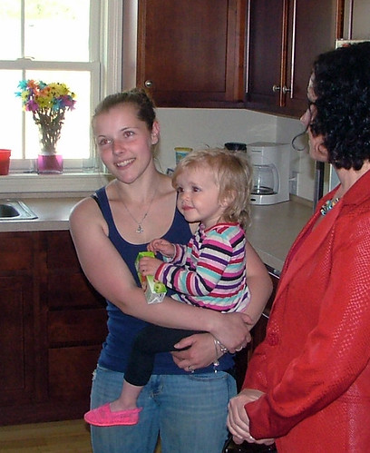 Pictured above are Heidi Richards and her daughter in their newly constructed Habitat home with Deputy Under Secretary, Patrice Kunesh.