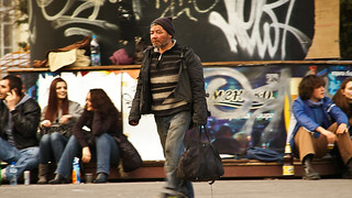 a homeless man in a hurry