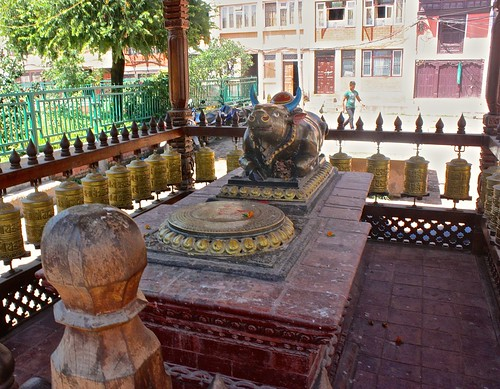 a bull and his prayer wheels outside of Patan