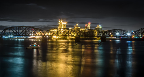 longexposure trestle panorama black reflection water night river lights evening boat industrial factory railway nighttime transportation starbursts colorimage landscapeorientation architecturephotography colourimage roomforcopy shadeofblue industrialstructure shadeofgray shadeofyellow